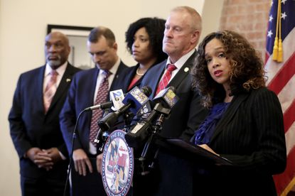 Baltimore City State's Attorney Marilyn Mosby, right, speaks during a news conference announcing the indictment of correctional officers on Tuesday, Dec. 3, 2019, in Baltimore. Twenty-five correction officers, most of whom were taken into custody earlier in the day, are charged with using excessive force on detainees at state-operated Baltimore pretrial correctional facilities.