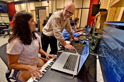 Noted musician Thomas Dolby speaks with sophomore Ashna Pathan as she works on a film score in the Music for New Media class at Peabody Institute. Pathan hopes to write music for television.