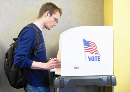 Towson University student Luke Monroe, from Parkville, casts a ballot at the college last April during early voting for Maryland's primary election. A series designed to help the community better understand how the American political system works launches this week at the Towson Library.