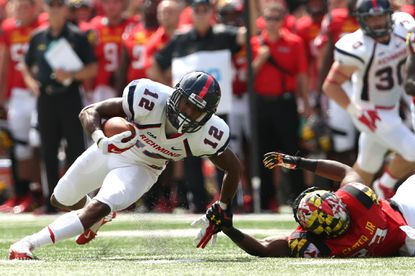 Wide receiver Brian Brown of the Richmond Spiders is tackled by Terps linebacker Jermaine Carter Jr. in the first half at Byrd Stadium on Sept. 5, 2015 in College Park.