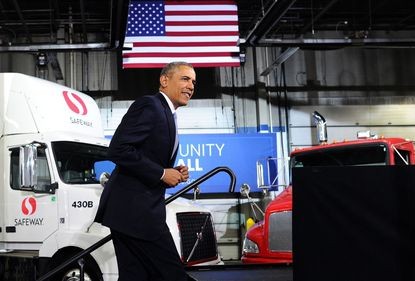 President Barack Obama walks on stage to speak on the economy at the Safeway Distribution Center in Upper Marlboro, Md.
