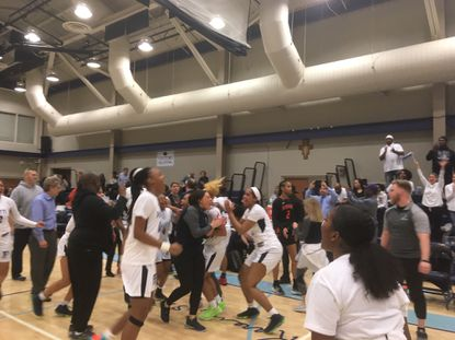Pallotti's Eniya Russell, left, celebrates after the Panthers' 46-44 win over McDonogh in the IAAM A Conference semifinals. Russell scored a game-high 20 points.