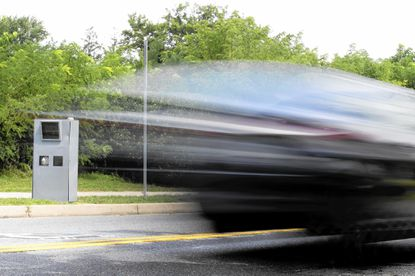 A car passes by a speed camera set up along Old Frederick Road near Westchester Elementary School in Catonsville, MD on Thursday, August 18, 2016.