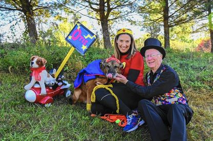 Superdog Otis with owner Tiffany Metzger, left, and magician Happy Jack Martin, at the Hunt Valley Rotary's First Annual Wheel to Heal event Oct. 29. The event benefited Pets on Wheels, for which Otis serves as a therapy dog.