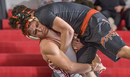 Glenelg's Drew Sotka, seen trying to take down Oakland Mills' Rocco DelPo last year, is Howard County's only returning state champion.