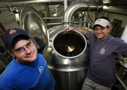 16 Mile owners Brett McCrea, left, and Chad Campbell, pictured at their brewery in 2009