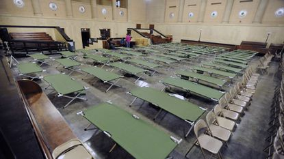 The Baltimore City Housing Department sets up cots and blankets in the War Memorial to house overflow from homeless shelters because of the bitter cold weather in February 2015.