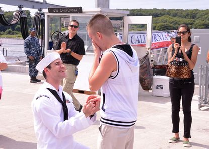 Navy machinist's mate Jerrel Revel proposes to his boyfriend, Dylan Kirchner, upon returning from a scheduled six-month deployment on a submarine.
