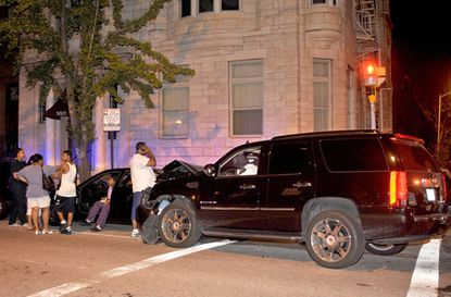 Michael Phelps' Cadillac Escalade is pictured after the Olympic champion swimmer was involved in a two-car collision Thursday night at the intersection of Calvert and Biddle Streets in Baltimore.