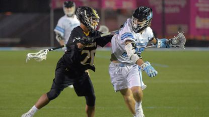 Senior defenseman Sid Ewell (left, pictured here against Johns Hopkins on Feb. 10, 2018) came off a suspension to play for the Towson men's lacrosse team on Saturday.