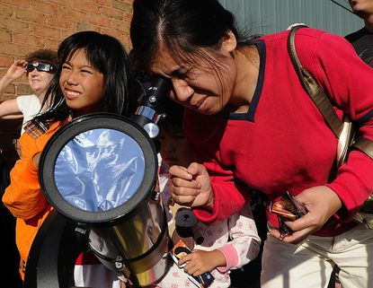 Ming Zheng looks at the Venus transit in Westminster in 2012. The transit of Mercury will occur Monday, Nov. 11 from about 7:35 a.m. to about 1:30 with several viewings scheduled around the county sponsored by the Westminster Astronomical Society.