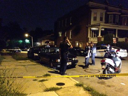 Police investigate a homicide in Southwest Baltimore's Franklintown Road neighborhood.