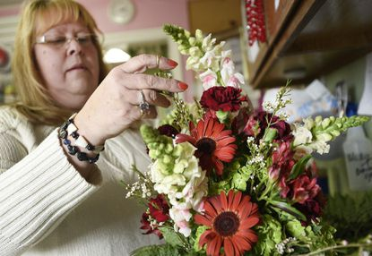 Jalna Brown designs a flower arrangement at Petals, Flowers and Gifts in Hampstead Friday, Feb. 2, 2018. Brown will be teaching floral design classes at Carroll Community College in Westminster.