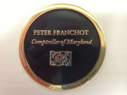 One side of Comptroller Peter Franchot's coin