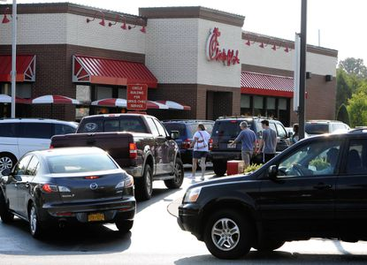 Customer files in, packing the Abingdon Chick-fil-A restaurant Wednesday eveningman to show their support for the restaurant chain after its owner/president tooka stance about gay marriage.