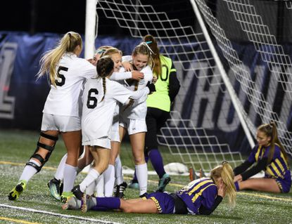 The Patterson Mill team celebrates after their goal in the first half by Madison Dawson in Thursday evening's Class 1A state final match against Loch Raven at Loyola University in Baltimore.