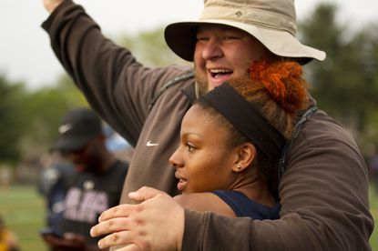 Howard girls track and field coach Tyler Wade, pictured here celebrating with Teanna Jules in 2015, is stepping down to focus on coaching football.