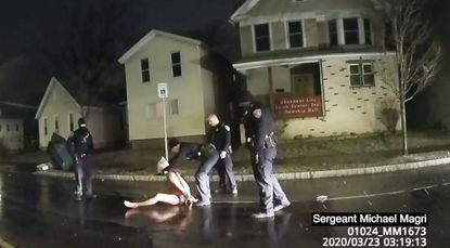 """FILE - In this image taken from police body camera video provided by Roth and Roth LLP on Sept. 2, 2020, a Rochester police officer puts a """"spit hood"""" over the head of Daniel Prude, on March 23, 2020, in Rochester, New York. Prude, who was said to be experiencing a mental health crisis, died in the incident."""