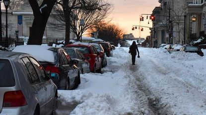 Mount Vernon Place is one of many side streets yet to be plowed Tuesday morning.