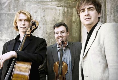 From left, cellist Sergey Antonov, violinist Misha Keylin and pianist Maxim Mogilevsky form the Hermitage Piano Trio, which will perform April 6 at Howard Community College's Smith Theatre.