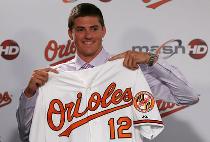 First-round draft pick Kevin Gausman shows off his new Orioles jersey at a news conference announcing his signing Friday evening at Camden Yards.