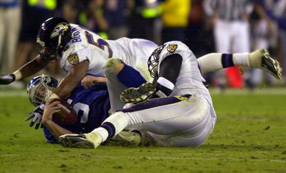 Ravens defenders Peter Boulware and Keith Washington sack Kerry Collins in Super Bowl XXXV in Tampa.