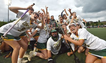 Century's players celebrate their victory over Fallston during the Class 2A-1A girls lacrosse state championship at Stevenson University.