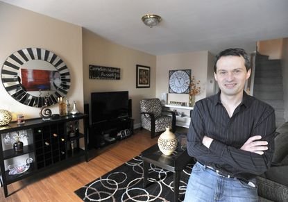 Alex Dyadyura is pictured in the living room of his dream home in Fells Point.