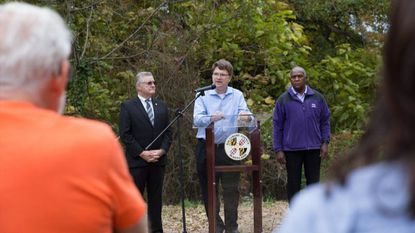 From left, County Executive Don Mohler, County Councilman Tom Quirk and Baltimore County Director of Recreation and Parks Barry F. Williams discuss the county's purchase of 4 acres of land in Lansdowne to preserve as open space.