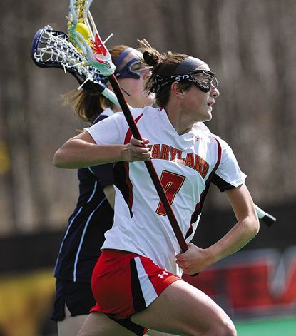 Maryland's Katie Schwarzmann (Century) advance the ball agains Penn State during a 2011 game in College Park.
