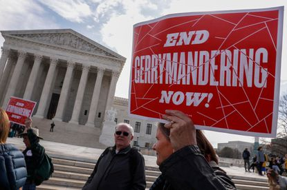 Protesters rally last year outside the Supreme Court, which heard a case regarding gerrymandering in Maryland. Some lawmakers in Maryland are calling for an end to gerrymandering in the state saying it is a form of voter suppression.