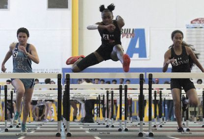McDonogh's Nyla Cherry wins the 55M hurdles during the 2020 IAAM/MIAA indoor track championships at Prince George's Sports and Learning Complex Fri., Jan. 17, 2020. (Karl Merton Ferron/Baltimore Sun Staff)