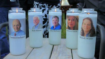 Candles honoring Gerald Fischman, Rob Hiaasen, John McNamara, Rebecca Smith, and Wendi Winters flicker as the sun sets during a candlelight vigil on Friday, June 29, 2018, at Annapolis Mall for the five Capital Gazette employees slain during a shooting spree in their newsroom.a