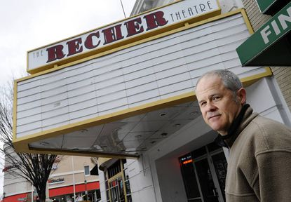 Brian Recher, co-owner of the Recher Theatre, stands in front of the Towson concert venue that opened in 1996. It will soon become the Torrent Nightclub.