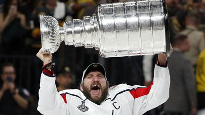 In this June 7, 2018, file photo, Washington Capitals left wing Alex Ovechkin hoists the Stanley Cup after the Capitals defeated the Golden Knights in Game 5 of the Stanley Cup Finals in Las Vegas.