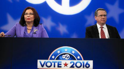 U.S. Rep. Tammy Duckworth and U.S. Sen. Mark Kirk wait for the third debate to begin at ABC 7 studios in Chicago on Nov. 4, 2016.