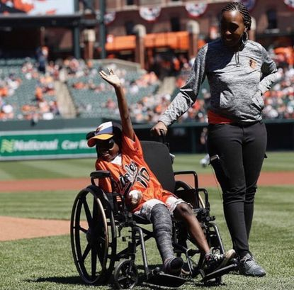 Mo Gaba is pictured after throwing out an opening pitch at an Orioles game.