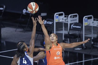 Minnesota Lynx guard Lexie Brown (4) goes up to shoot in front of Connecticut Sun center Brionna Jones during the first half of a WNBA basketball game Sunday, July 26, 2020, in Bradenton, Fla. (AP Photo/Phelan M. Ebenhack)