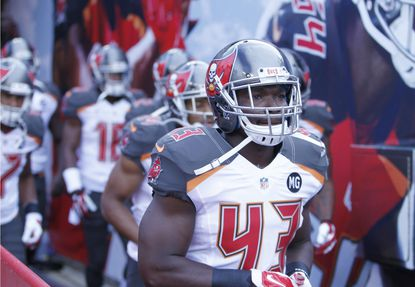Tampa Bay Buccaneers running back Bobby Rainey takes the field for warmups before preseason action against the Miami Dolphins.