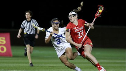 Erica Evans (33), a graduate student midfielder for the Maryland women's lacrosse team who transferred from Canisius, has eased her way into the starting midfield with Jen Giles and Grace Griffin.