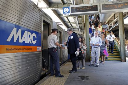 Riders board a MARC train en route to Washington D.C. at Penn Station on Charles Street.