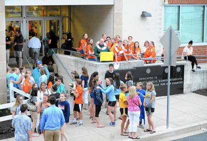 Part of the crowd gathered for last week's Harford County Board of Education meeting stands outside the A.A. Roberty Building unable to get inside the packed school board budget meeting.