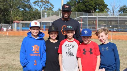 Orioles reliever Mychal Givens poses for a photo with participants at his charity Wiffle ball tournament last weekend. Givens hosted it to raise money for his soon-to-be-formed charity, the Givens Back Foundation