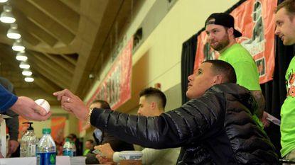 Orioles third baseman Manny Machado signs autographs for fans at a previous FanFest.