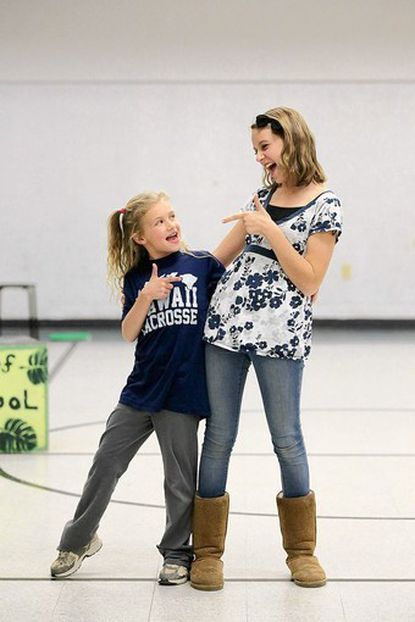 """Youth Theatre of Northern Baltimore County's Alison Dobbyn, left, 9, of Upperco, and Rachel Larkin, right, 13, of Parkton, sing a duet during rehearsal of """"Children's Letters to God"""" at Our Lady of Grace School in Parkton to be performed Nov. 8."""