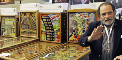 For the third time in two years, David Silverman, pictured here at the January 2012 opening of his National Pinball Museum in Baltimore, needs to find a home for his collection.