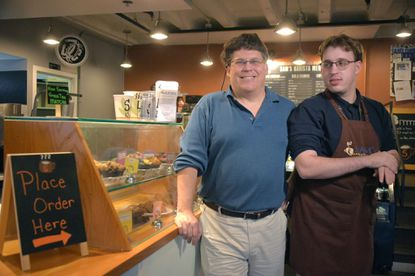 Sam Myers beside his father, Michael Myers, at Sam's Canterbury Cafe.