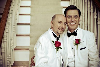 Tom and Jim share a moment on their wedding day.