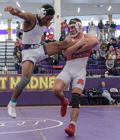 Clement Woods (Mount St. Joseph), left, defeated Joe Fisk (Archbishop Spalding) in the 138 pound weight class finals. The annual Mount Mat Madness wrestling tournament took place on Saturday, December 28. 12-28-2019
