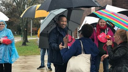 District 12 State Del. Clarence Lam greets voters at Hillcrest Elementary School in Catonsville on Election Day Tuesday. Lam handily won his bid for the state Senate seat representing that district.